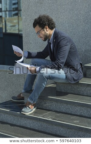 Business man reading paper outside Stock photo © IS2