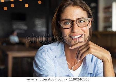 portret · glimlachend · aantrekkelijke · vrouw · bril · jas · poseren - stockfoto © deandrobot