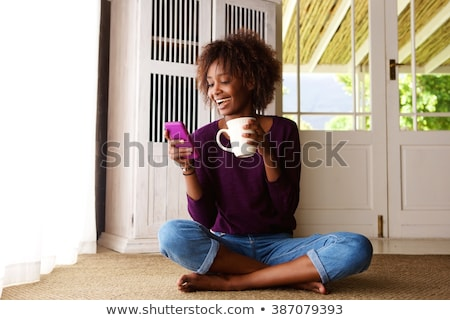 full length portrait of a happy laughing afro american woman stock photo © deandrobot