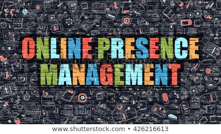 Online Presence Management on Dark Brick Wall. Stock photo © tashatuvango