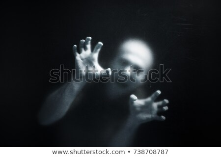 Screaming man behind a dusty scratched glass  Stock photo © sqback