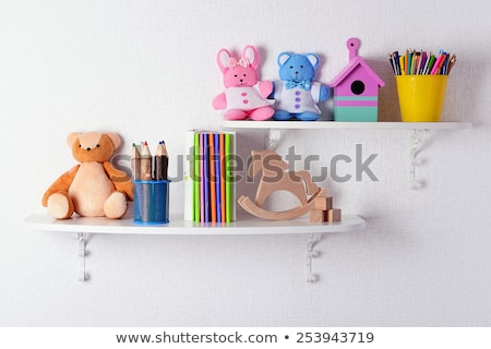 many toys and books on wooden shelves stock photo © bluering