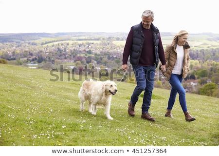 Középkorú pár kéz a kézben férfi védelem kint Stock fotó © IS2