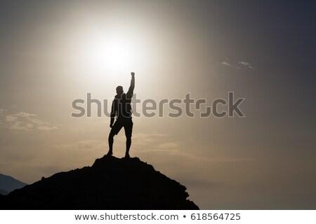 man celebrating inspiring mountains view stock photo © blasbike