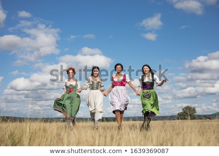 Rire heureux oktoberfest femme traditionnel Photo stock © Fisher