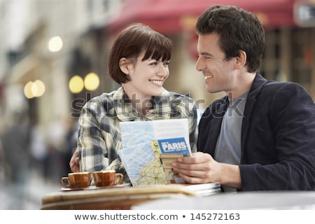 Happy couple reading guidebook Stock photo © IS2
