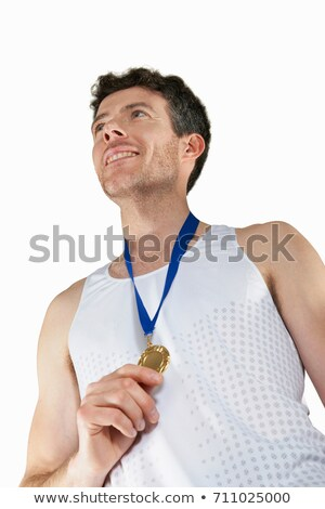 Man in running gear wearing medal Stock photo © IS2