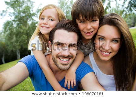 happy family photographing by smartphone in summer stock photo © dolgachov
