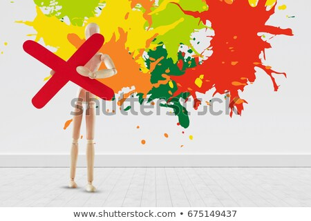 Wooden figurine holding multiplication sign Stock photo © wavebreak_media