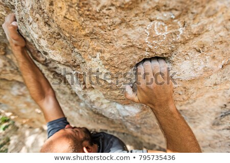 Hand of a rock climber Stock photo © IS2