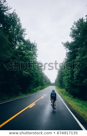 silhouette of cyclist riding down the road stock photo © mikhailmishchenko