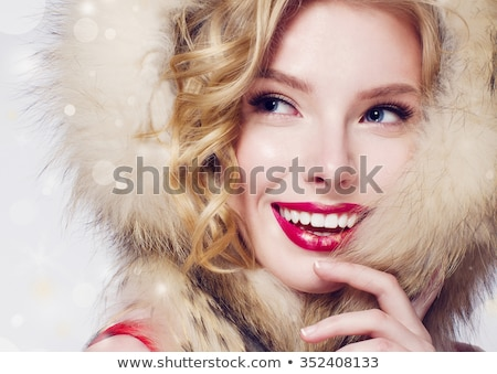 Portrait of woman in white fur hood Stock photo © IS2