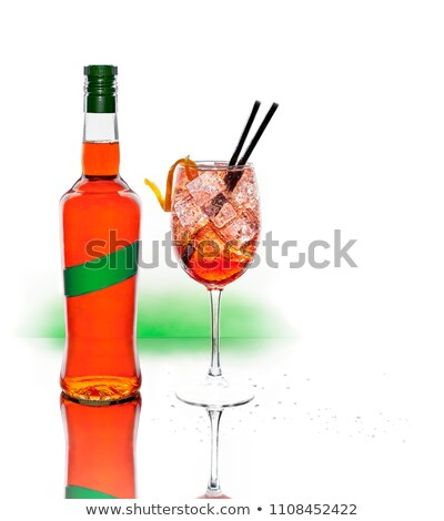 A liquor bottle and a cup of Spritz, typical Italian cocktail. Stock photo © Photooiasson