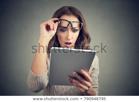 Shocked woman watching tablet in amazement Stock photo © ichiosea