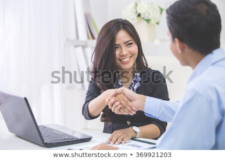 businesswoman shaking hands with her partner stock photo © andreypopov