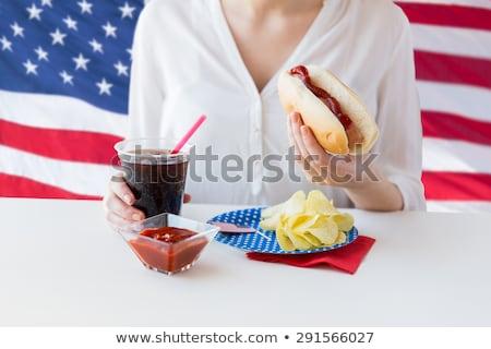 vrouw · eten · hot · dog · cola · amerikaanse - stockfoto © dolgachov