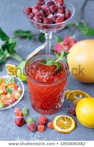 Raspberry and mint leaf on a frozen slice of orange Stock photo © flariv
