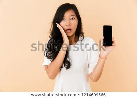 Asiatic femeie prezinta izolat bej Imagine de stoc © deandrobot