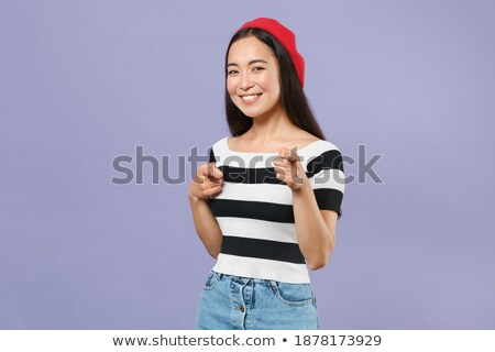 Young asian beautiful attractive woman posing isolated indoors pointing. Stock photo © deandrobot