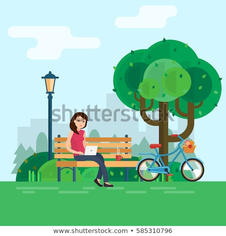 Woman Freelance Worker Sitting on Bench in Park Stock photo © robuart