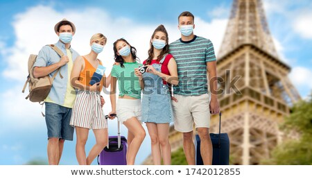 friends with travel bags over eiffel tower Stock photo © dolgachov