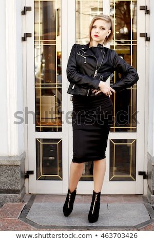 Beautiful smiling woman wearing in striped dress and leather jacket. Stock photo © studiolucky