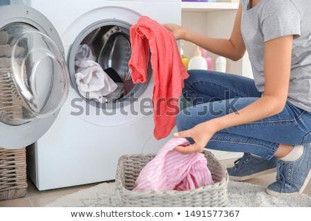 Jeune femme buanderie machine à laver coup femme Photo stock © dashapetrenko