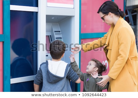 Boy taking cash from ATM Stock photo © jossdiim