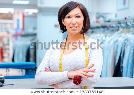 Propriétaire chimiques textiles propre magasin fier Photo stock © Kzenon