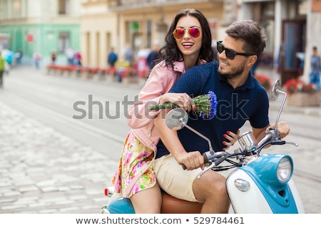 Happy young couple together on motorbike Stock photo © deandrobot
