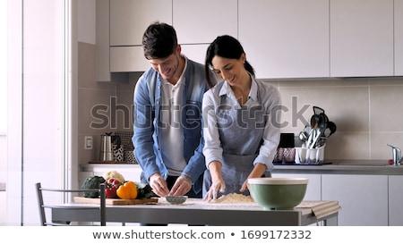 Pizza cocina junto rústico mujer Foto stock © boggy