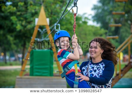 jongen · swing · gelukkig · glimlachend · park · speeltuin - stockfoto © lopolo