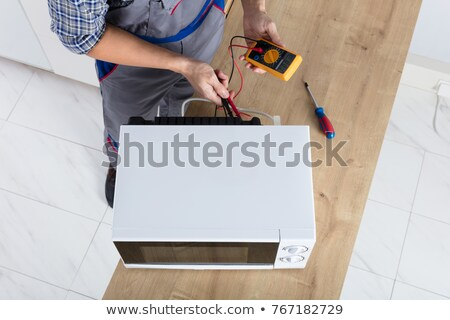 Technician Holding Microwave Stock photo © AndreyPopov
