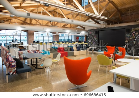 Interior of modern loft office open space with desks Stock photo © pressmaster