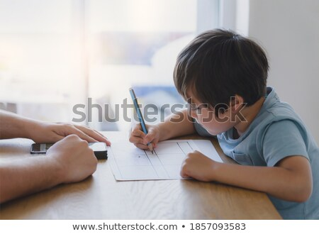 two boys of primary reading and doing homework together stock photo © ijeab