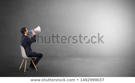 Businessman staying in an empty room with stuffs on his lap Stock photo © ra2studio
