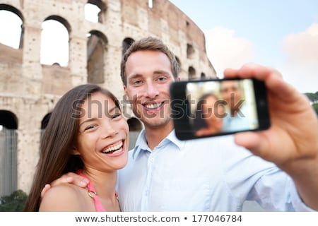 Couple Taking Selfie In Front Of Colosseum Stock photo © AndreyPopov
