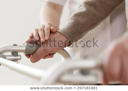 Enfermera ayudar altos hombre caminando marco Foto stock © Kzenon