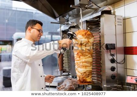 Szakács szeletel hús nyárs kebab bolt Stock fotó © dolgachov