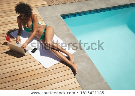 High angle view of young African American woman using laptop in her backyard on a sunny day Stock photo © wavebreak_media
