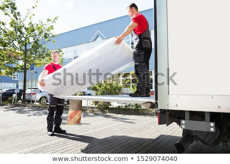 Young Men Unloading The Mattress From Truck On Street Stock photo © AndreyPopov