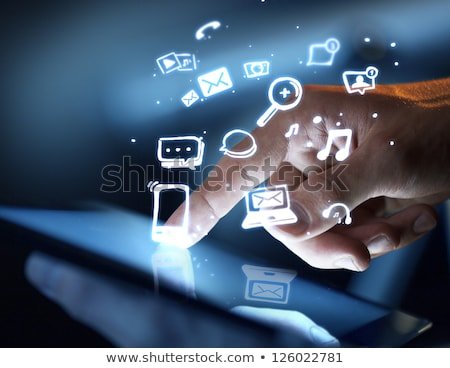 finger touching tablet with social media icons concept stock photo © ra2studio