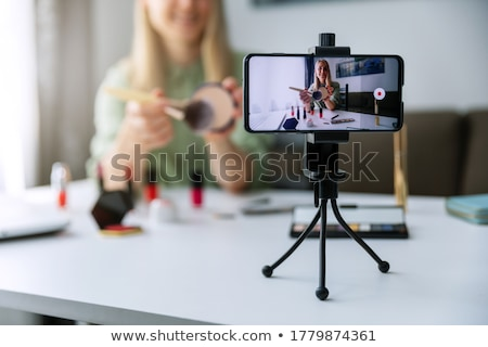 Makeup Beauty fashion blogger recording video presenting cosmeti Stock photo © snowing