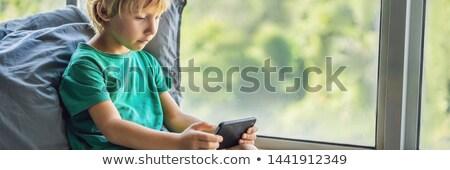 ブロンド 少年 演奏 ゲーム スマートフォン ストックフォト © galitskaya