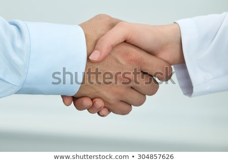 Partnership, assistance, trust and medicine concept. Female doctor shakes hands with thankful patien Stock photo © vkstudio