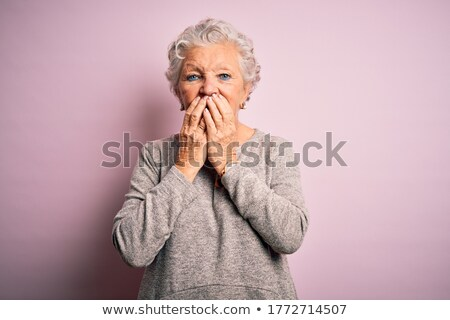 happy woman covering mouth by hand and giggling Stock photo © dolgachov