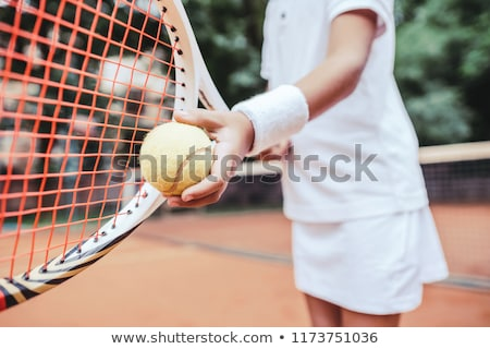 Woman serving the ball in tennis match Stock photo © Kzenon