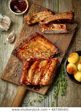 Picante carne de porco costelas alho molho de churrasco Foto stock © Dar1930