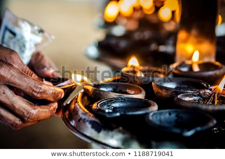 Burning candles in Buddhist temple Stock photo © dmitry_rukhlenko