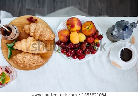 Two coffee cups and Italian coffee maker with croissant and fruits  Stock photo © Illia